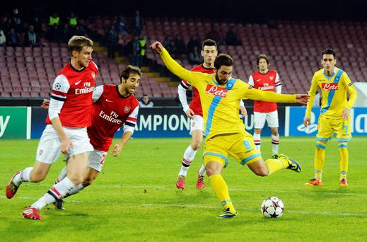 Napoli's Gonzalo Higuain scores, during a Champions League, group F, soccer match between Napoli and Arsenal, at the Naples San Paolo stadium, Italy