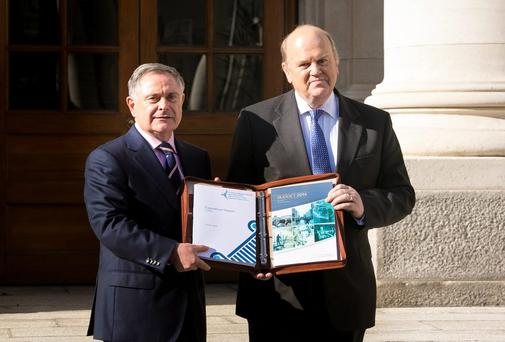 Minister for Public Expenditure Brendan Howlin and Minister for Finance Michael Noonan present the 2014 Budget