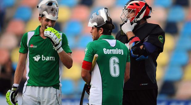 David Ames (L) of Ireland prepares for a penalty corner with team mates Ronan Gormley (C) and goalkeeper David Harte (R)