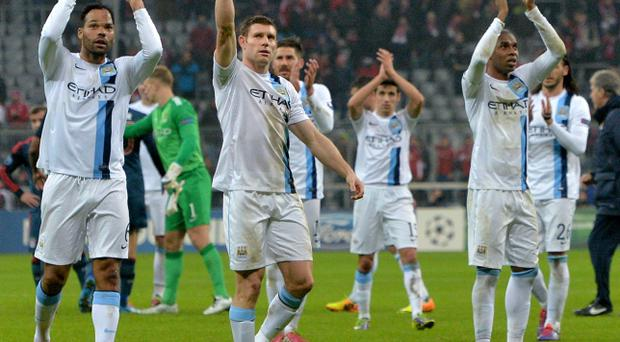 Manchester City's James Milner, second left, lifts a thumb after the Champions League group D soccer match between FC Bayern Munich and Manchester City, in Munich, southern Germany, Tuesday, Dec. 10, 2013. Manchester defeated Munich by 3-2. (AP Photo/Kerstin Joensson)