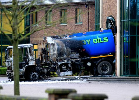A burnt out oil truck that was rammed into the headquarters of the Aventas Group (formerly known as the Quinn Group) in Derrylin, Co Fermanagh