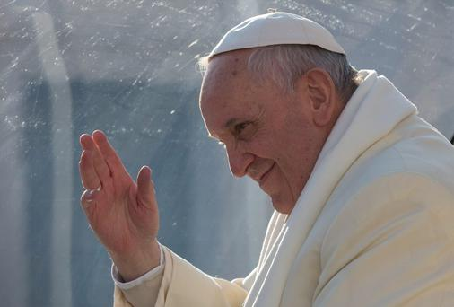 Pope Francis waves as he leaves after his weekly general audience in St. Peter's Square at the Vatican earlier this week