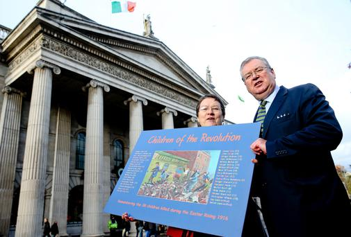 RTE's Joe Duffy with his painting which has been made into a card as he seeks help in researching children who died violently in the Rising, with author Ann Mathews