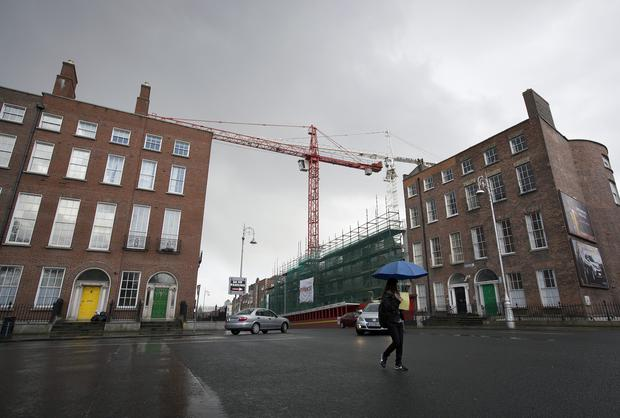 A crane towers above a new block of residential apartments under construction at Lower Gardiner Street in Dublin.