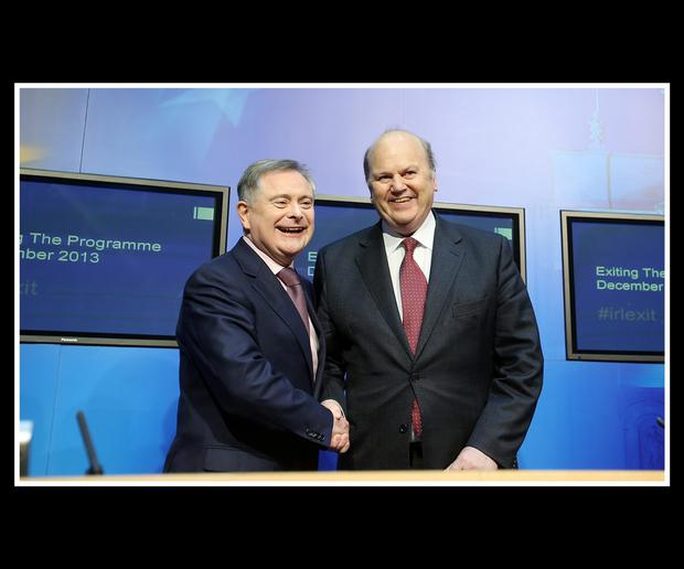 Brendan Howlin Minister for Expenditure and Public Reform pictured in celebratory mood with Minister for Finance Michael Noonan