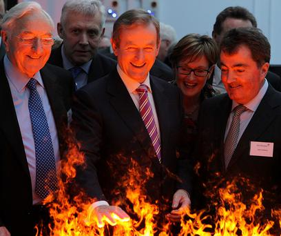 Taoiseach Enda Kenny feels the heat while visiting the Glen Dimplex plant at Dunleer, Co. Louth. Photo: Paul Connor