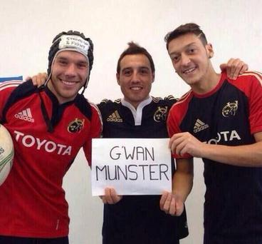 Arsenal stars Lukas Podolski, Santi Cazorla and Mesut Ozil pose in Munster kits