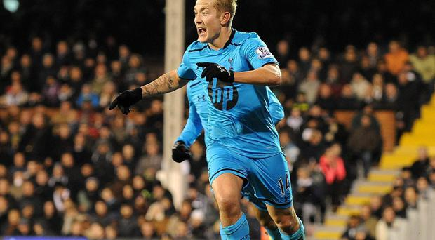 Lewis Holtby of Tottenham Hotspur celebrates scoring their second goal during the Barclays Premier League match at Craven Cottage, London. PRESS ASSOCIATION Photo. Picture date: Wednesday December 4, 2013. See PA story SOCCER Fulham. Photo credit should read: Tony Marshall/PA Wire. RESTRICTIONS: Editorial use only. Maximum 45 images during a match. No video emulation or promotion as 'live'. No use in games, competitions, merchandise, betting or single club/player services. No use with unofficial audio, video, data, fixtures or club/league logos.