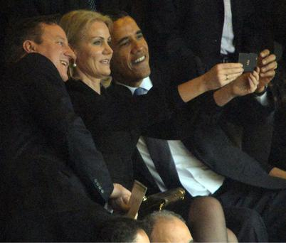 Barack Obama and David Cameron posing for a selfie with Helle Thorning Schmidt.