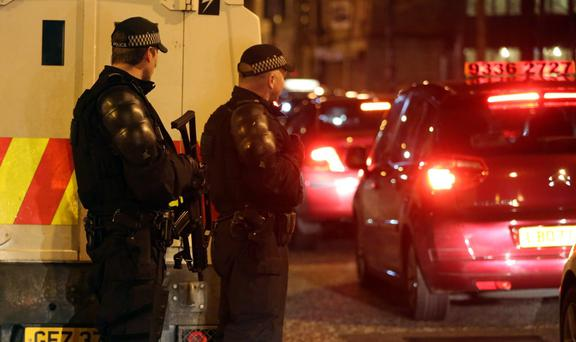 Armed Police seal off the Cathedral Quarter in Belfast after a small explosion in Belfast city centre, police said the incident came after a telephone bomb warning had been made