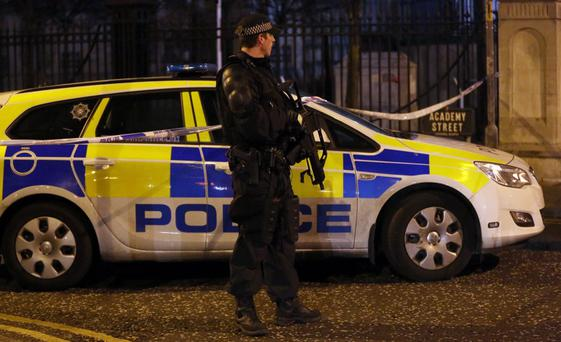 Armed Police seal off the Cathedral Quarter in Belfast after a small explosion in Belfast city centre, police said the incident came after a telephone bomb warning had been made. PRESS ASSOCIATION Photo. Picture date: Friday December 13, 2013. Photo credit should read: Paul Faith/PA Wire