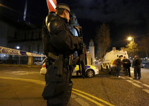 Armed Police seal off the Cathedral Quarter in Belfast last week after the attack