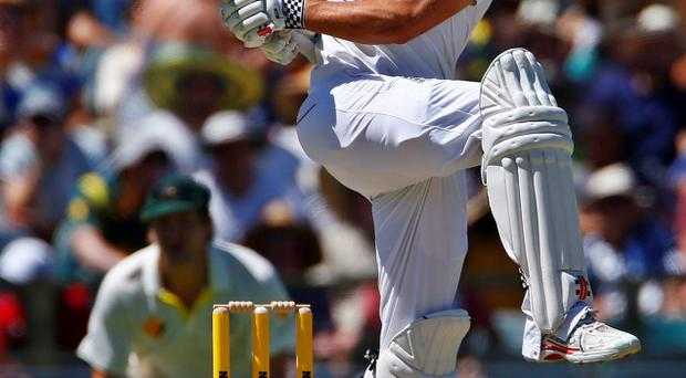England's captain Alastair Cook plays a hook shot during the second day of the third Ashes test cricket match against Australia at the WACA ground in Perth today