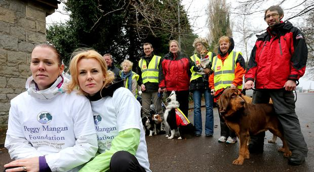 Orla Lynch and Louise Mangan, daughters of Peggy Mangan who was found dead near IKEA in Ballymun pictured at the start of a charity walk from Mount Jerome to Ballymun. Picture; GERRY MOONEY. 14/12/13
