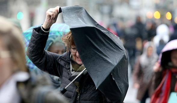 Shoppers battle the wind and rain in Dublin City centre. Picture; GERRY MOONEY. 14/12/13