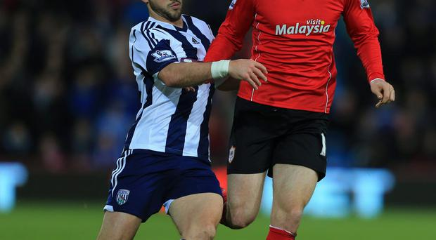 West Bromwich Albion's Shane Long chases back and tackles Cardiff City's Jordon Mutch