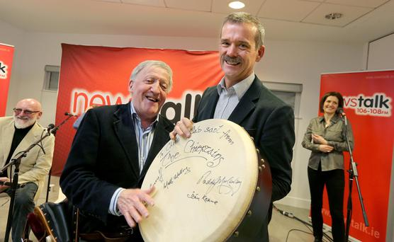 Paddy Moloney of the Chieftans presents retired Canadian astronaut Chris Hadfield with as signed Bodhran in the Science Gallery in trinity college. Picture; GERRY MOONEY. 14/12/13