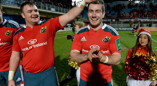 Munster's late try scorer JJ Hanrahan is congratulated by team-mate Dave Kilcoyne after defeating Perpignan.