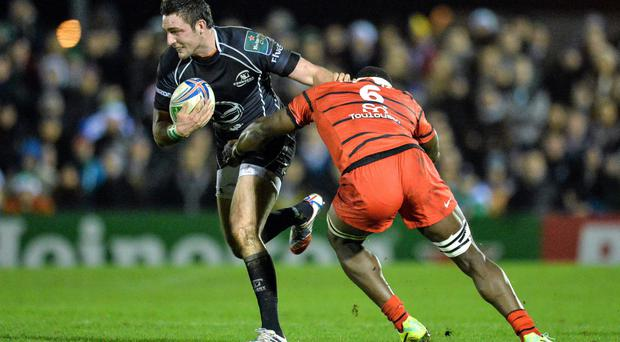 Dave McSharry, Connacht, is tackled by Yannick Nyanga