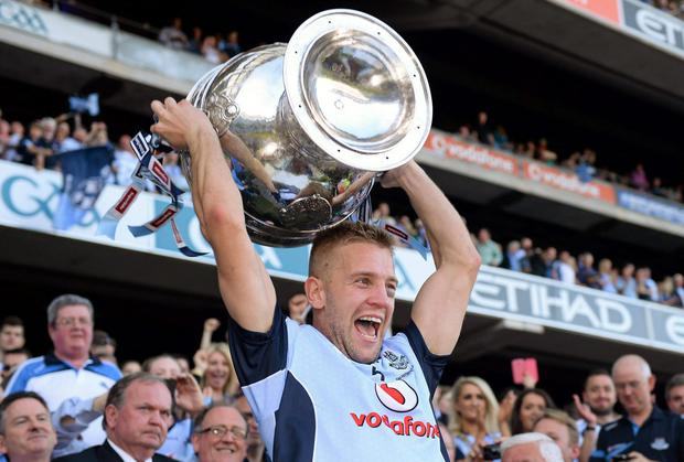 Dublin's Jonny Cooper lifts the Sam Maguire last year