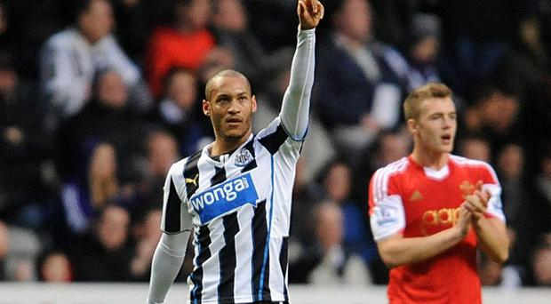 Newcastle United's Yoan Gouffran (left) celebrates scoring the opening goal of the game