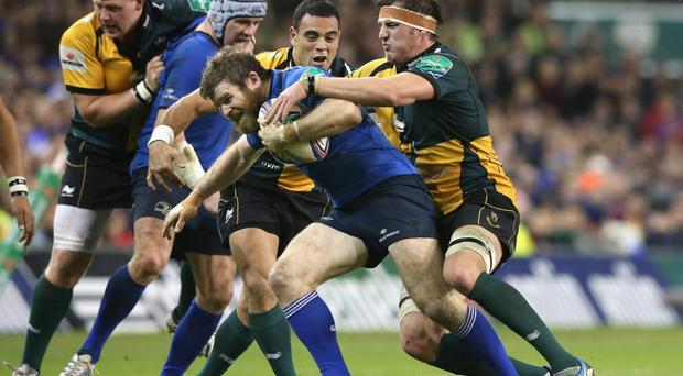 Gordon D'Arcy of Leinster is tackled by Tom Wood during the Heineken Cup pool 1 match between Leinster and Northampton Saints