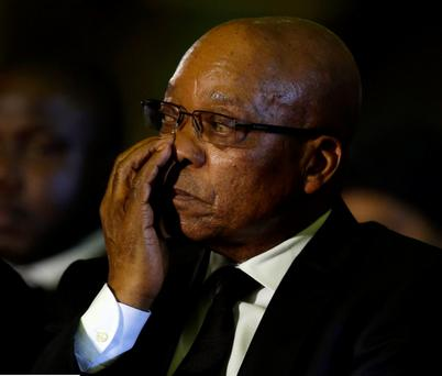 South African President Jacob Zuma wipes his eyes while attending a farewell ceremony for former South African President Nelson Mandela by the African National Congress