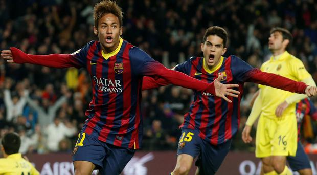 Barcelona's soccer player Neymar (L) and Marc Bartra celebrate a goal against Villarreal during their Spanish First division League soccer match at Camp Nou stadium in Barcelona December 14, 2013. REUTERS/Albert Gea (SPAIN - Tags: SPORT SOCCER)