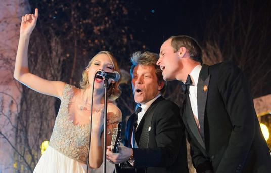 Taylor Swift performs with Bon Jovi and Prince William