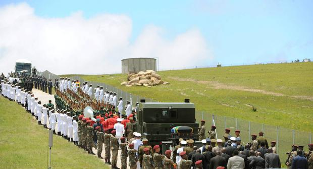 The coffin of South African former president Nelson Mandela is carried on a gun carriage for a traditional burial in after the funeral ceremony in Qunu