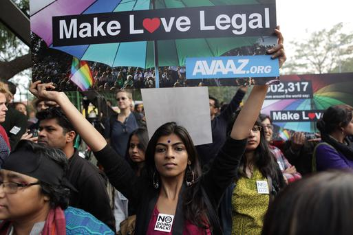 Indian gay rights activists hold placards during a protest against a Supreme Court verdict that upheld section 377 of the Indian Penal Code that criminalizes homosexuality in New Delhi, India