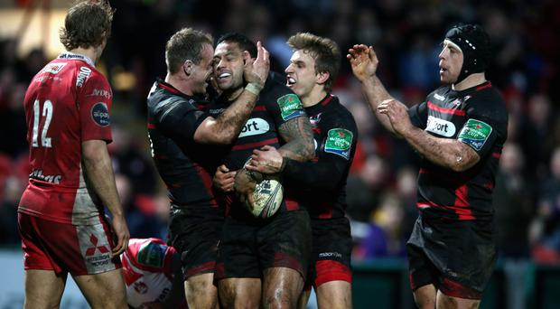 Ben Atiga of Edinburgh is congratulated by team mates after scoring a try