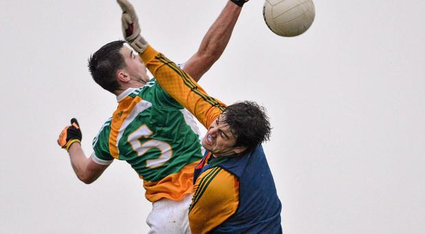 Owen Carroll, Offaly, beats Meath goalkeeper Conor McHugh to score the side's third goal