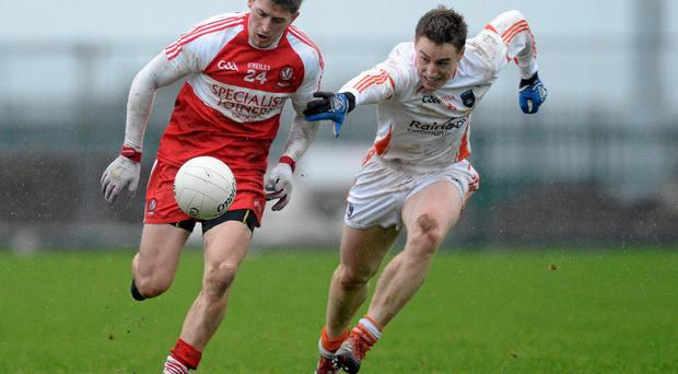 Declan Mullan, Derry, in action against Charlie Vernon, Armagh