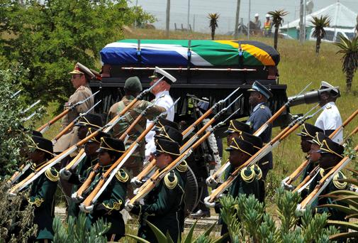 The coffin of former South African President Nelson Mandela is transported on a gun carriage for his funeral ceremony in Qunu, Eastern Cape