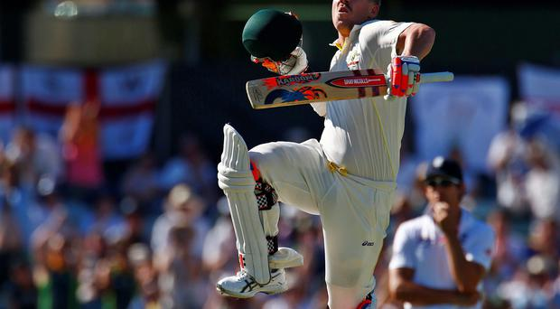 David Warner leaps with delight after scoring a century in Australia's second innings against England