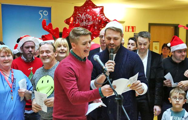 Brian Ormond and Brian McFadden sing with hospital staff and celebrities at the Celebrity Ward Wark at Our Lady's Children's Hospital, Crumlin. Picture Colin Keegan, Collins.
