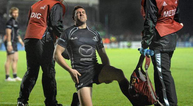 Craig Ronaldson, Connacht, holds his leg after he was injured during the game against Toulouse