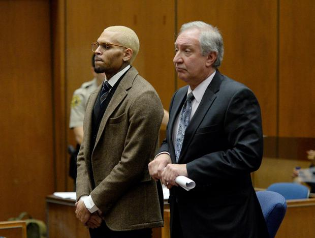 R&B singer Chris Brown appears in court with his attorney Mark Geragos for a probation violation hearing during which his probation was revoked by a Los Angeles Superior judge. (Photo by Kevork Djansezian/Getty Images)