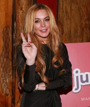"NEW YORK, NY - DECEMBER 16: Lindsay Lohan attends the ""Just Sing It"" app launch event at Pravda on December 16, 2013 in New York City. (Photo by Robin Marchant/Getty Images)"