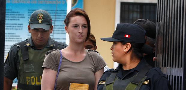 Irish-born Michaella McCollum, handcuffed, arrives for a court hearing, in Lima, Peru, Tuesday, Dec. 17, 2013. McCollum along with Melissa Reid, of Britain, were detained on Aug. 6 at Lima's airport for allegedly trying to smuggle cocaine on a flight to Spain and were formally charged for drug trafficking. (AP Photo/Karel Navarro)