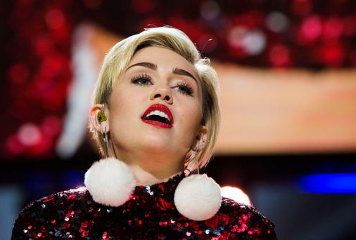 Singer Miley Cyrus performs during the Jingle Ball in New York earlier this week. Photo: Reuters