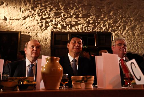 Iconic attraction: China's then vice president Xi Jinping with Finance Minister Michael Noonan (left) and Tanaiste Eamon Gilmore (right) at Bunratty Castle during a visit by a Chinese group to Ireland in 2012