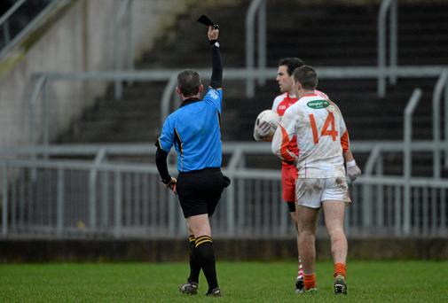 Ethan Rafferty, Armagh, is shown a black card by referee Brendan Rice. O'Fiach Cup Final, Armagh v Derry, Crossmaglen, Co. Armagh