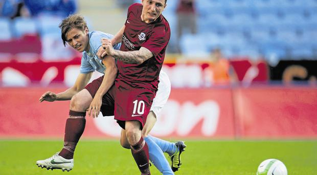 Drogheda's Gary O'Neill in action against Simon Thern of Malmo in the European League earlier this year
