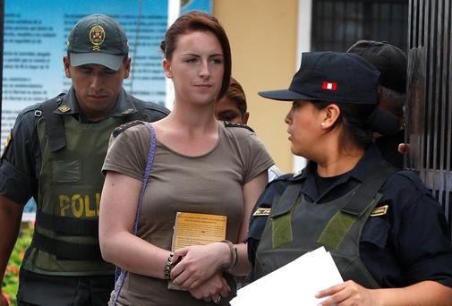 Michaella McCollum, handcuffed, arrives for a court hearing, in Lima, Peru, yesterday.