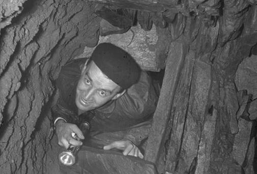 Peter Danaher, the first Director of the Archaeological Survey of Ireland (1963-72) and later Chief Archaeologist (1972-84), surveying a souterrain in the 1960s.