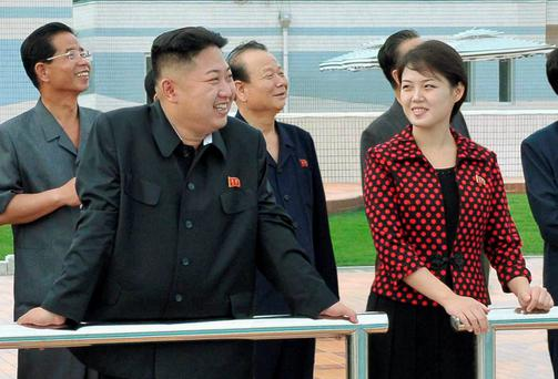 Dictator Kim Jong Un pictured with his wife Ri Sol-ju. The petite former singer has not been seen in public for at least 48 days.