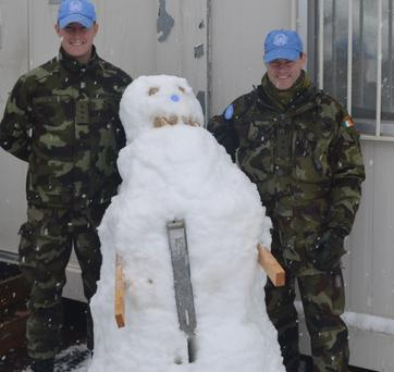Captain Brian Connolly and Lieutenant Donal Mitchell in Lebanon show off their snowman. Photo: Irish Defence Forces/Flickr