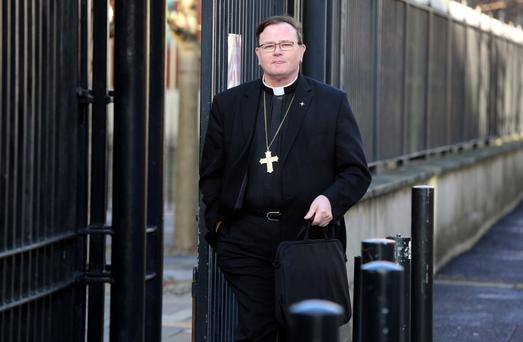 Independent bishop Pat Buckley outside Belfast Crown Court where he avoided a prison term for conducting 14 sham marriages to flout immigration law. PRESS ASSOCIATION Photo. Picture date: Thursday December 19, 2013. Buckley, 61, helped Bangladeshi men marry Portuguese women in Northern Ireland. He was sentenced to three-and-a-half years, suspended for three years.